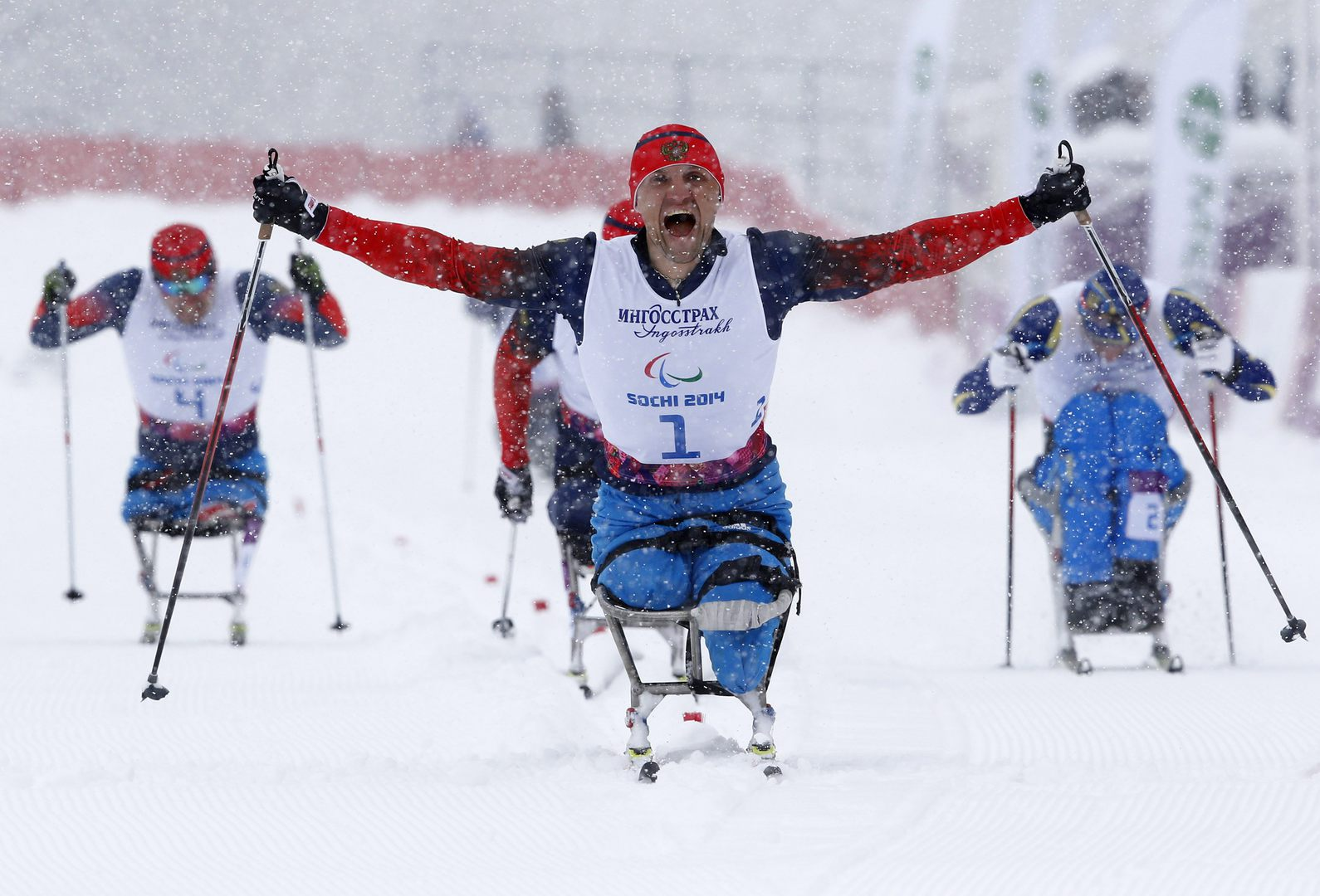 Russia's Roman Petushkov celebrates his gold medal during the men's 1 km sprint cross-country sitting at the 2014 Sochi Paralympic Winter Games in Rosa Khutor, March 12, 2014. REUTERS/Alexander Demianchuk (RUSSIA - Tags: SPORT SKIING OLYMPICS TPX IMAGES OF THE DAY)